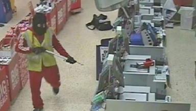 CCTV image of Nikolas McGregor in Co-op, Hamilton, North Lanarkshire, threatening shop staff with a spear gun.