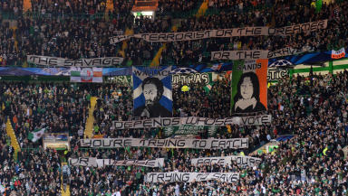 Celtic fans show a banner during their game with AC Milan.