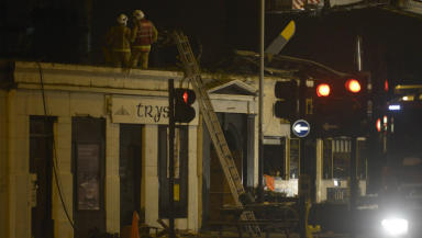 Firefighters at the scene of the police helicopter crash at the Clutha Vaults pub, November 29 2013.