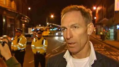 Jim Murphy speaking at the scene of the Glasgow helicopter crash