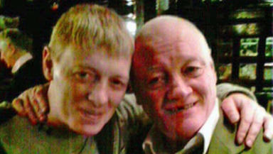 John (right) pictured with his son.