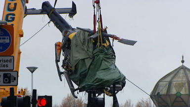 The helicopter being lifted from the crash site.