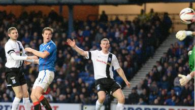 Jon Daly heads Rangers into a 1-0 lead.