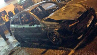 A 19-year-old man has been charged with reckless conduct after a car burst into flames at tribute to Paul Walker.