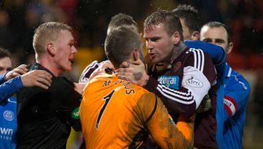 Referee Brian Colvin (2nd left) is forced to step in as St Johnstone keeper Alan Mannus (2nd right) and Hearts' Ryan Stevenson (right) square up, which results in the two players being sent off.