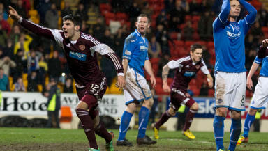 Hearts Callum Paterson (left) celebrates his captain Danny Wilson's (not pictured) late equalising goal.