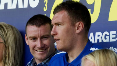 Stephen Elliott (left) joined Kevin Kyle in the stands at Tynecastle on Saturday, ahead of his switch to Hearts.