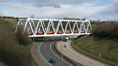 Railway bridge over M80 motorway near Junction one and two Blochairn and Robroyston carrying Stepps Cumbernauld railway line