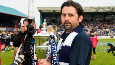 Dundee manager Paul Hartley celebrates with the trophy