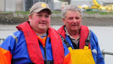 Rescued fishermen Jim Reid and David Irvine return on dry land in Montrose on an RNLI boat. May 22 2014