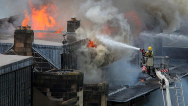 Firefighter and flames at the Glasgow School of Art. May 23 2014