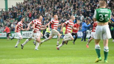 Hamilton celebrate winning promotion against Hibernian.