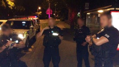 Allegedly armed police in Aberdeen, faces blurred.Taken by Kevin Forbes during his questioning over alleged traffic offence.