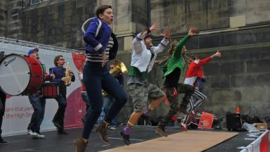 Performers can be seen on the streets around Edinburgh.