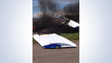 Grab from a video sent to us of a light aircraft crash on the Isle of Bute, August 10, 2014.