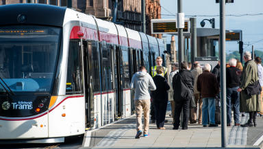 Quality image of Edinburgh Trams with current livery at tram stop from Transport for Edinburgh