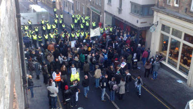 Face-off: Police and anti-fascist demonstrators on Royal Mile.