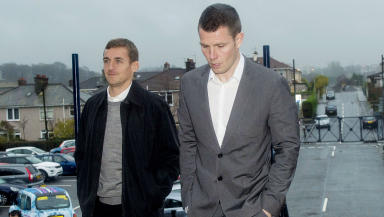 QOTS manager James Fowler (left) and Andrew Dowie arrive at Hampden ahead of his hearing.