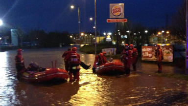 Rescue teams save staff and customers from flooding at Asda in Kilmarnock on December 22 2014. Image from Police Scotland.