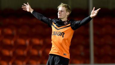 Gary Mackay-Steven celebrates adding to Dundee Utd's lead.