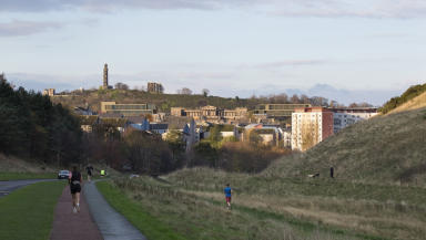 Image shows proposed hotel at old Royal High School on Calton Hill, Edinburgh from Queen's Drive in Holyrood Park. From architects.