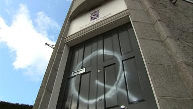 Graffiti: A Q is painted on the door of Labour's offices in Rosemount place Aberdeen.