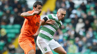 Celtic captain Scott Brown (right) holds off Alexei Eremenko