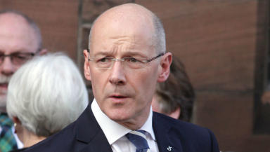 John Swinney: Education secretary urged not to proceed.
