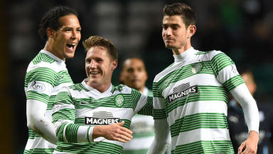 Nir Bitton enjoys his moment of glory as Celtic team-mates Virgil Van Dijk (left) and Kris Commons (centre) congratulate him on his fantastic strike
