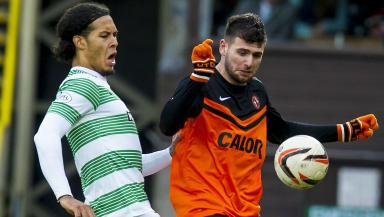 Celtic's Virgil Van Dijk (left) and Nadir Ciftci battle for possession.