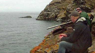 Scottish Wild Salmon Company gunmen shooting seals in Crovie, Aberdeenshire on June 15 2015. Uploaded June 17 2015.