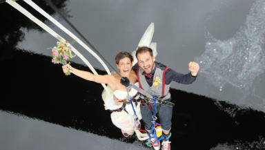 Groom Ross Basham from North London and bride Hannah Phillips from Suffolk after their bungee jump wedding.