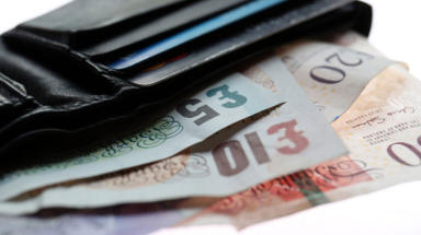 Photo of money in a wallet. Generic money image, cash, wallet, banknotes. Quality news image uploaded August 25 2015.
