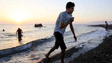 Migrants and refugees coming ashore on beach on island of Kos, Greece Europe Migration immigration Quality news image uplaoded August 3 2015