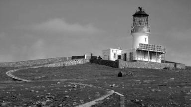 Flannan Lighthouse where three lighthouse keepers vanished in 1900. Black and white image from Geograph. Creative Commons, uploaded October 14 2015.