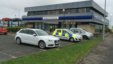Armed robbery at Kirkcaldy Bank of Scotland. Pic from broadcast on scene. Uploaded on Nov 11 2015.