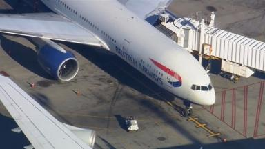 A passenger on board a British Airways flight was reportedly restrained after trying to get into the cockpit of a flight from the UK to Boston in the US.