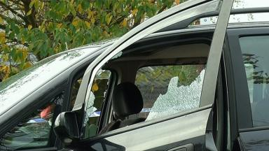 The smashed window of the vehicle from last week's incident in the same area