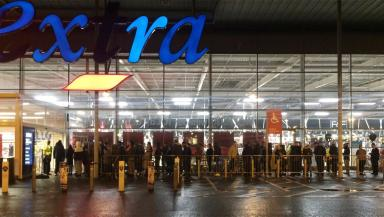 Tesco Extra: Crowds patiently queue outside the store at Silverburn in Glasgow.