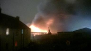 Blaze: People evacuated after fire rips through car garage.