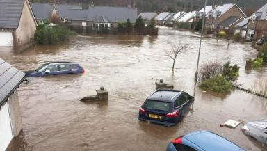 Storm Frank: Homes in Ballater flooded as water engulfs streets during Storm Frank.