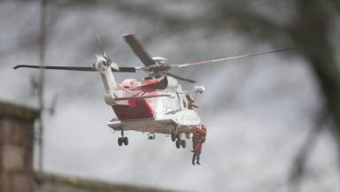Rescue: Helicopter rescues stranded residents in Ballater.