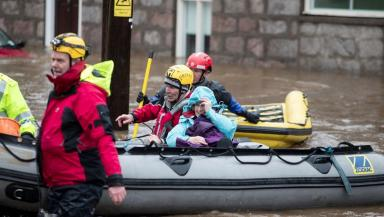 Flood: Emergency services lead residents to safety in Ballater.