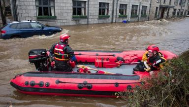 Residents in Ballater rescued on dinghies during Storm Frank on December 30 2015. Image from Derek Irosnside/Newsline