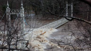 Cambus o May suspension bridge just outside Ballater after Storm Frank. Image uploaded December 30 2015 from Derek Ironside/Newsline