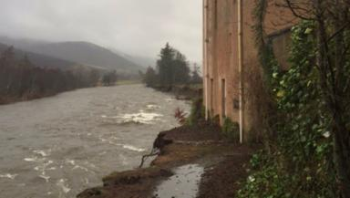 Collapse risk: The River Dee swept away land next to Abergeldie Castle.