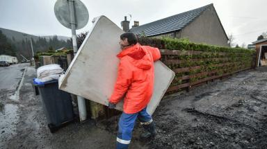 Ballater: Man clears home damaged by flooding in town.