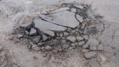 Pothole: Scotland's roads are facing a backlog of work.