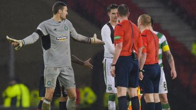 Celtic's Craig Gordon talks with Referee Craig Thomson at full-time
