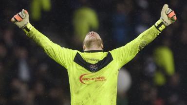 Scott Fox celebrates Ross County's win over Celtic.